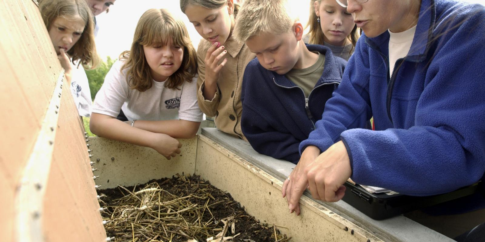 Fiifth graders from Roynon Elementary School in La Verne learn how worms can make compost during a tour of the Lyle Center