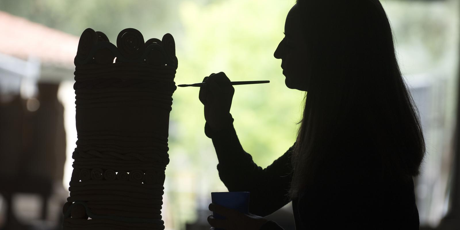 A student glazes her coil pot in the Ceramics Studio (Tom Zasadzinski)