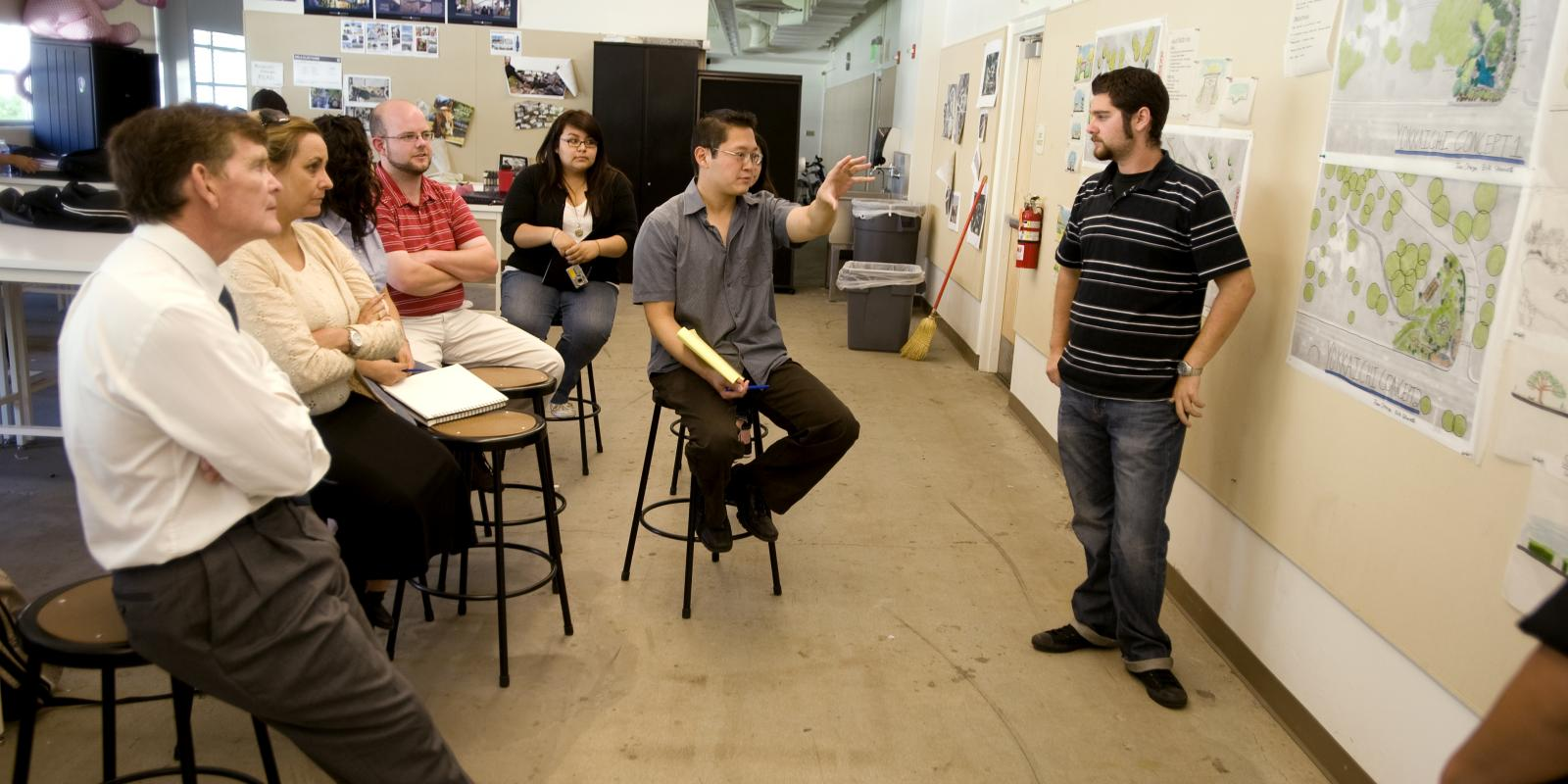 Professionals attend a critique in lecturer Keiji Uesugi's LA 303 studio