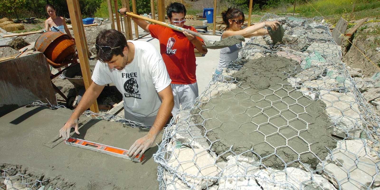 Regenerative studies and architecture students work on an alternative construction home at the Lyle Center, May 2006