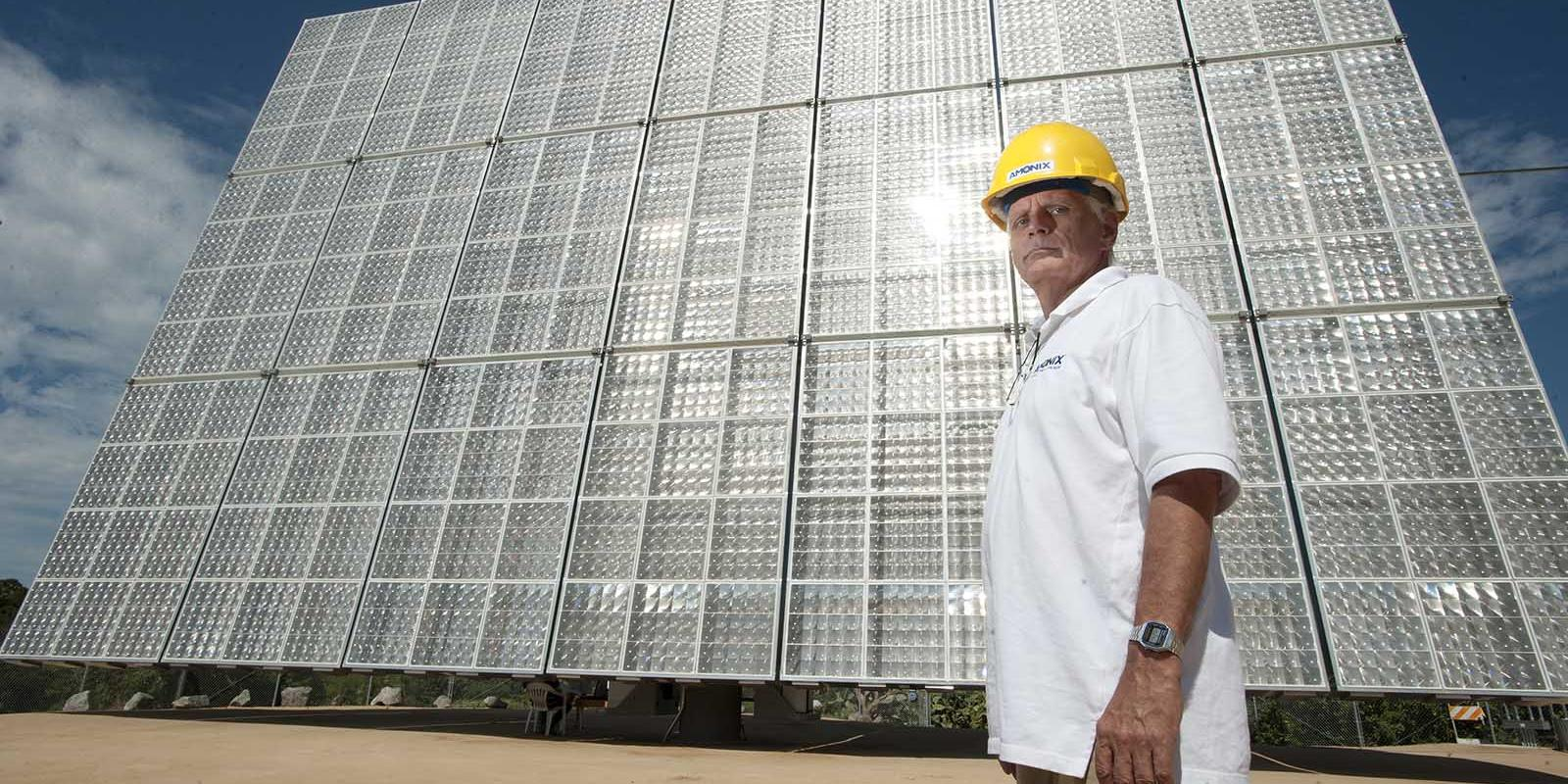 Jim Schwerin, principal electrical engineer stands with Amonix solar panels at the Lyle Center, August 2010