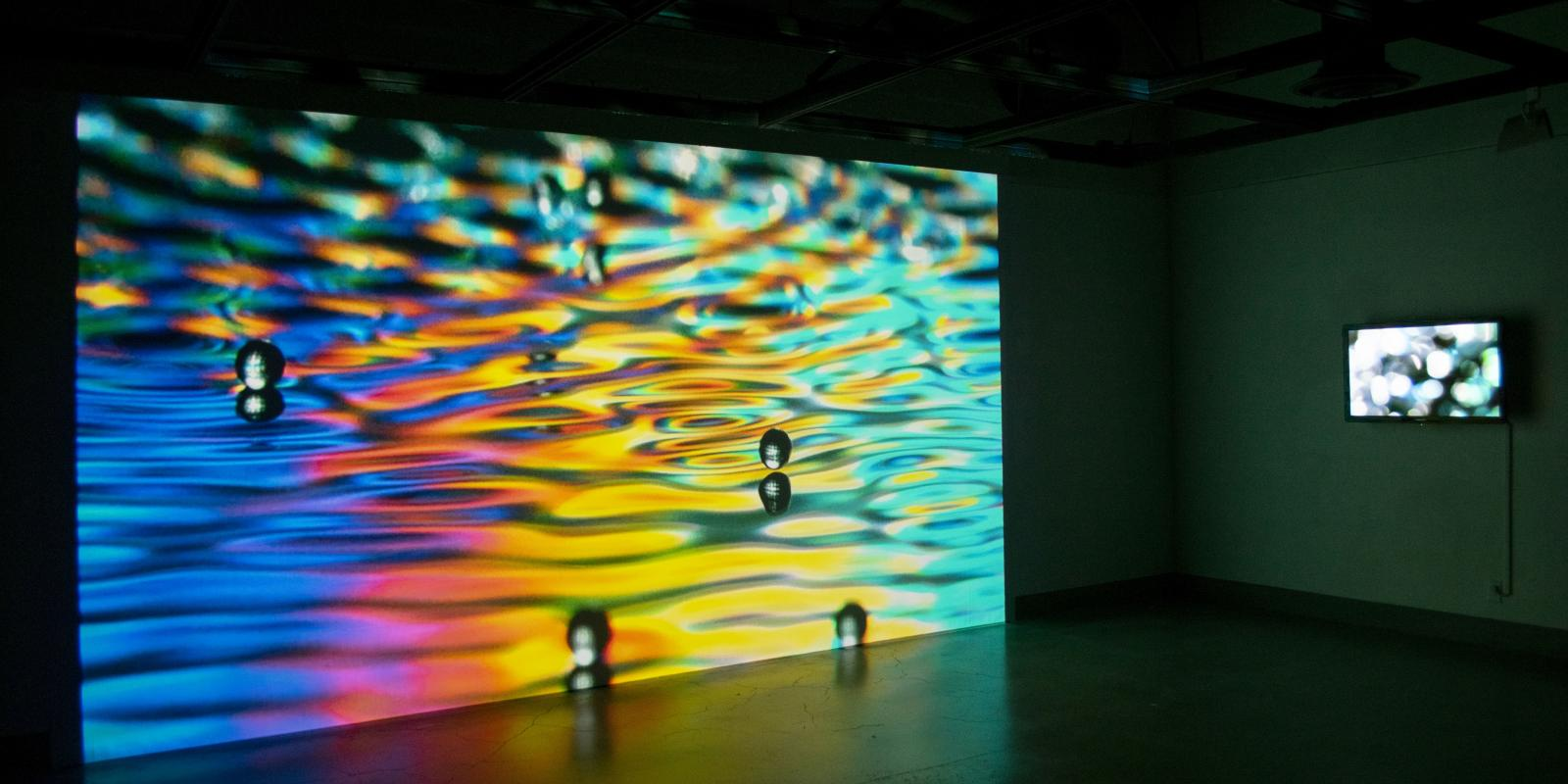 Back of gallery, Exhibition: Sasha vom Dorp: 15.15 Hz, Aug. 23 - Oct. 18, 2018, Curator: Michele Cairella Fillmore, W. Keith & Janet Kellogg Art Gallery, Cal Poly Pomona. [15.15 Hz consists of images, as well as interactive light-based, multisensory video sound installations that capture sunlight at 15.15 Hz (Photo Credit: William W. Gunn)]