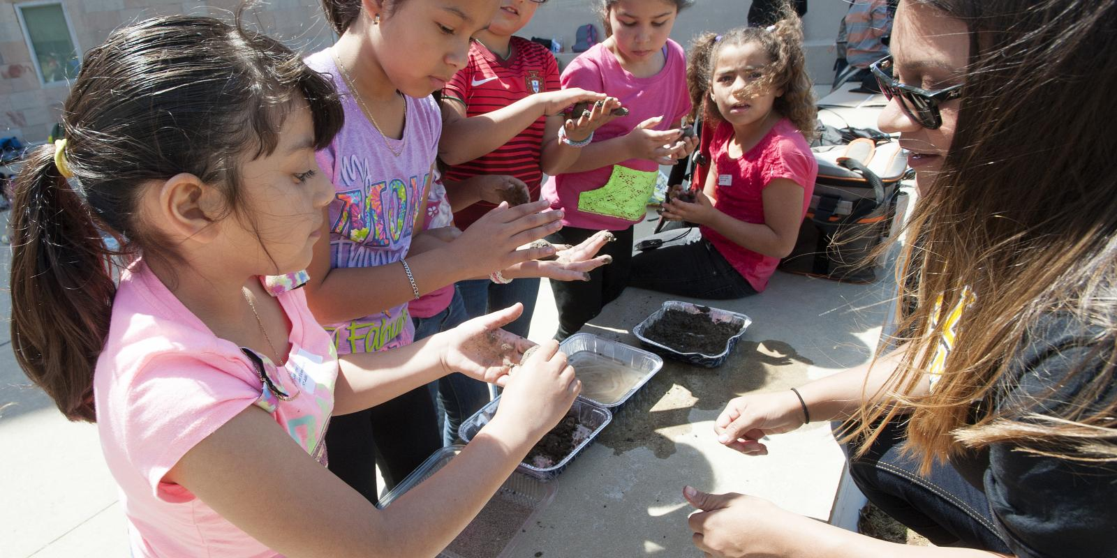 Westmont Elementary School students make seed balls as part of the Regenerative Community Fellowship Program, April 8, 2015