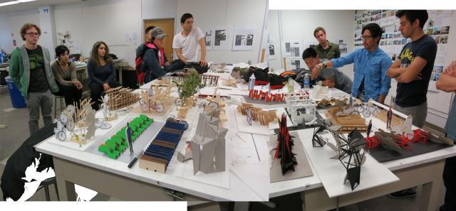 Students in Assistant Professor Robert Alexander's undergraduate studio discuss their projects.