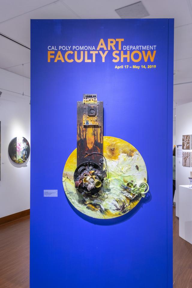 2019 Faculty Show Title Wall with art piece by Ann Phong