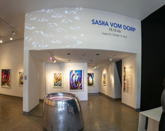 Title wall entrance view of the gallery, Exhibition: Sasha vom Dorp: 15.15 Hz, Aug. 23 - Oct. 18, 2018, Curator: Michele Cairella Fillmore, W. Keith & Janet Kellogg Art Gallery, Cal Poly Pomona. [Sasha vom Dorp: 15.15 Hz exhibition entrance (Photo Credit: William W. Gunn)]