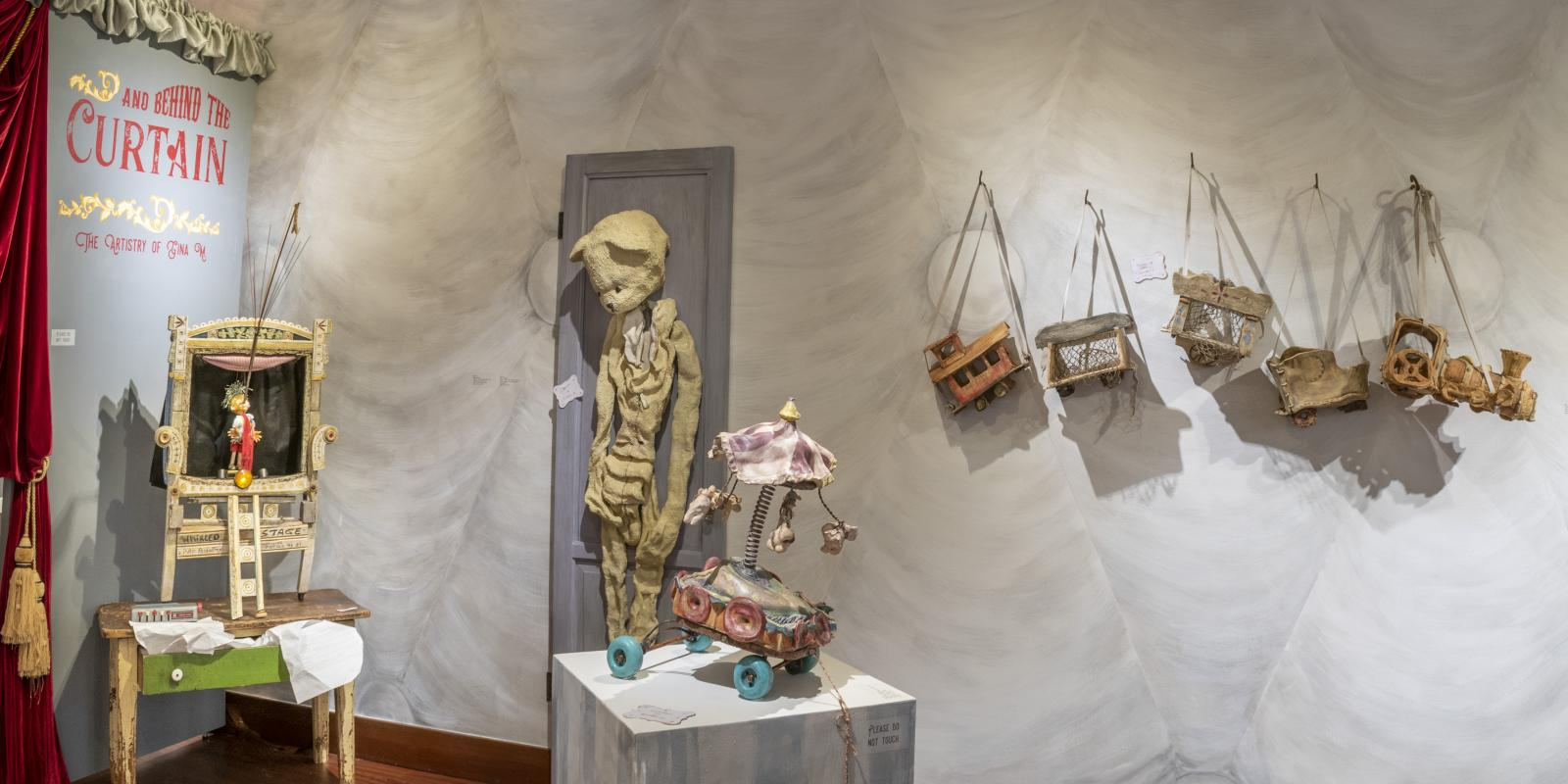 """Installation View, Front of gallery, """"Through the Toy Shop and Behind the Curtain: The Artistry of Gina M."""" Exhibition, Jan. 21, 2020 extended through Dec. 13, 2020 (extended indefinitely after Dec. 13, 2020), Curator: Michele Cairella Fillmore, Don B. Huntley Gallery, Cal Poly Pomona."""