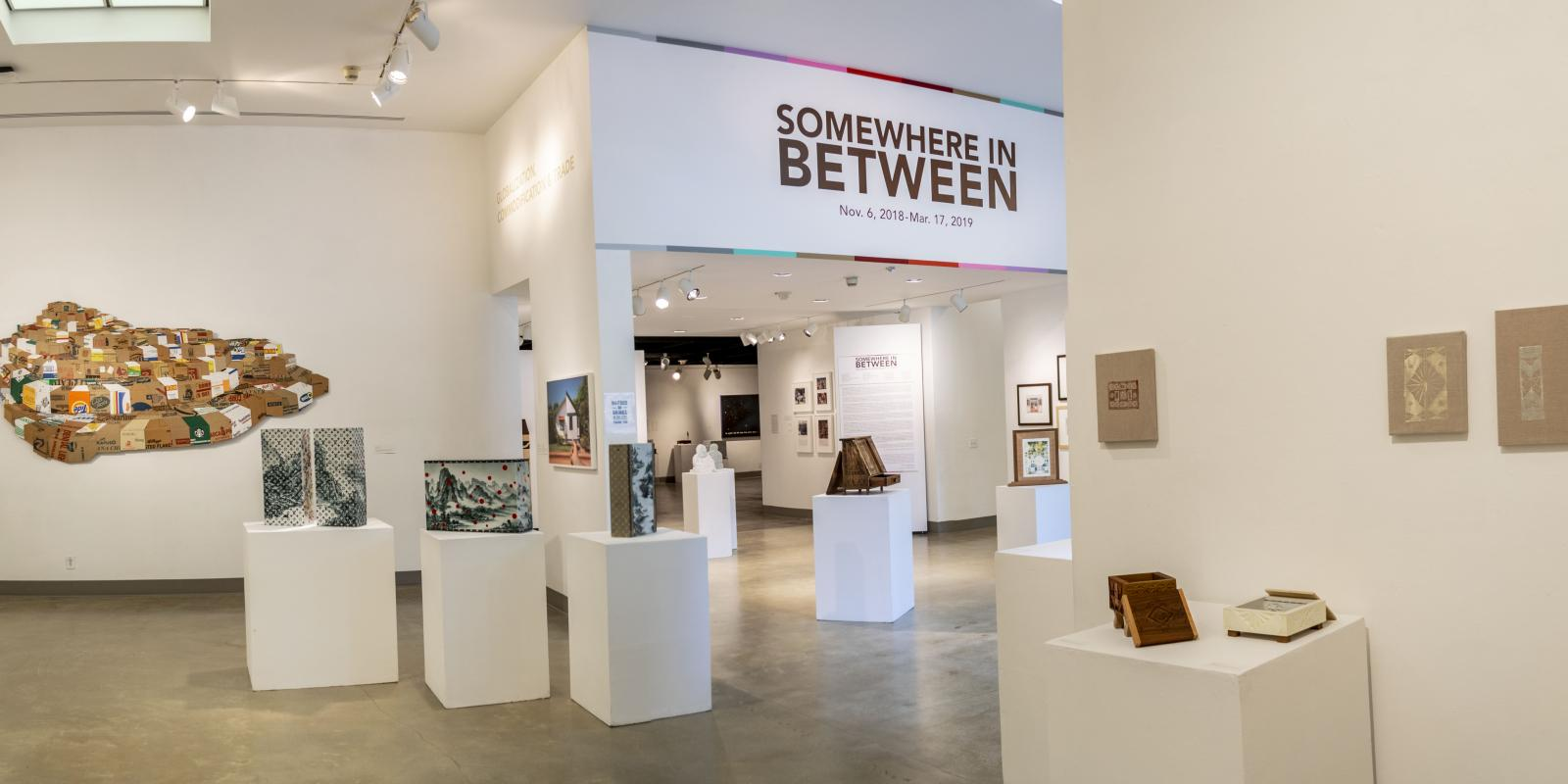 Front eastside view of the gallery, Exhibition: Somewhere In Between, Nov 6, 2018 - Mar 17, 2019,  Co-curated by Michele Cairella Fillmore & Bia Gayotto, W. Keith & Janet Kellogg Art Gallery, Cal Poly Pomona.