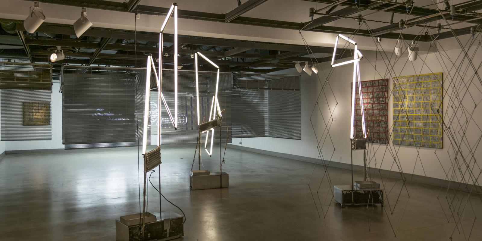 Back of the gallery, Exhibition: David Jang: Systems of Production, Feb 22 - Apr 26, 2018, Curator: Michele Cairella Fillmore, W. Keith & Janet Kellogg Art Gallery, Cal Poly Pomona. [Gallery Shot showing 3 of David Jang's Most dynamic works]
