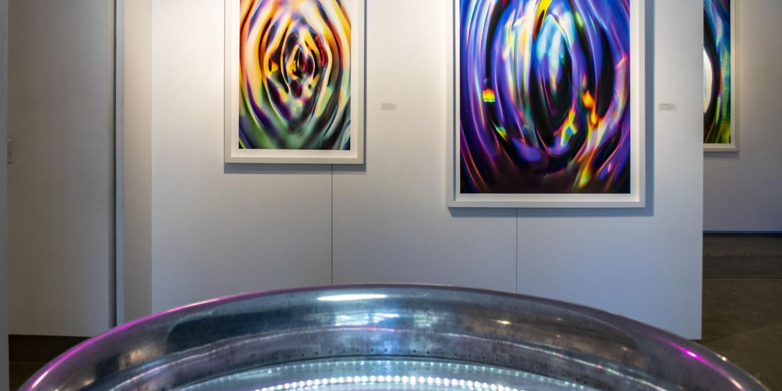 Front of gallery, Exhibition: Sasha vom Dorp: 15.15 Hz, Aug. 23 - Oct. 18, 2018, Curator: Michele Cairella Fillmore, W. Keith & Janet Kellogg Art Gallery, Cal Poly Pomona. [In foreground: a jet engine part redesigned by the artist as a machine to quiver, pulse and tremble water surface (Photo Credit: William W. Gunn)]