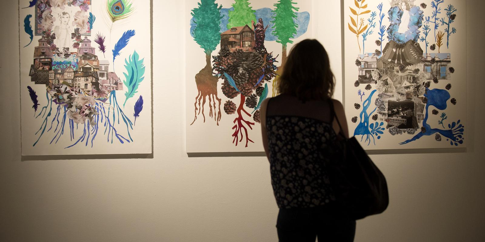 A guest views Karin Skiba's mixed media collage Detroit #4, 6, 8, July 2014