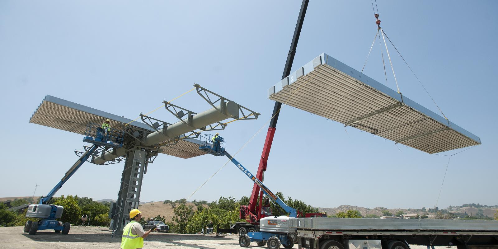 Workers install solar panels at the Lyle Center, June 2010