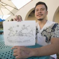 VCD major Carlos Aceytuno with his original sketch of the 2019 Cal Poly Universities Rose Float (Image by Tom Zasadzinski)
