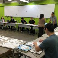 ART 352 students pitch their design ideas to a Sowing Seeds for Life representative (Image by Sooyun Im)