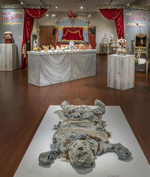 """Installation View, Entrance of Gallery and Title Wall, """"Through the Toy Shop and Behind the Curtain: The Artistry of Gina M."""" Exhibition, Jan. 21, 2020 extended through Dec. 13, 2020 (extended indefinitely after Dec. 13, 2020)"""