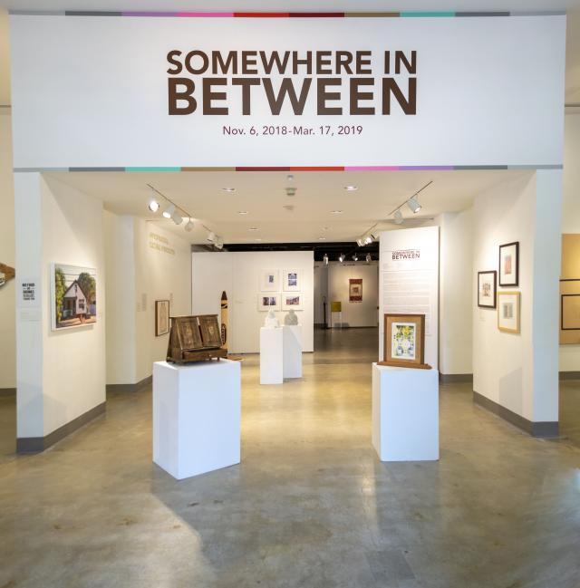 Title Wall entrance view of the gallery, Exhibition: Somewhere In Between, Nov 6, 2018 - Mar 17, 2019, Co-curated by Michele Cairella Fillmore & Bia Gayotto, W. Keith & Janet Kellogg Art Gallery, Cal Poly Pomona.