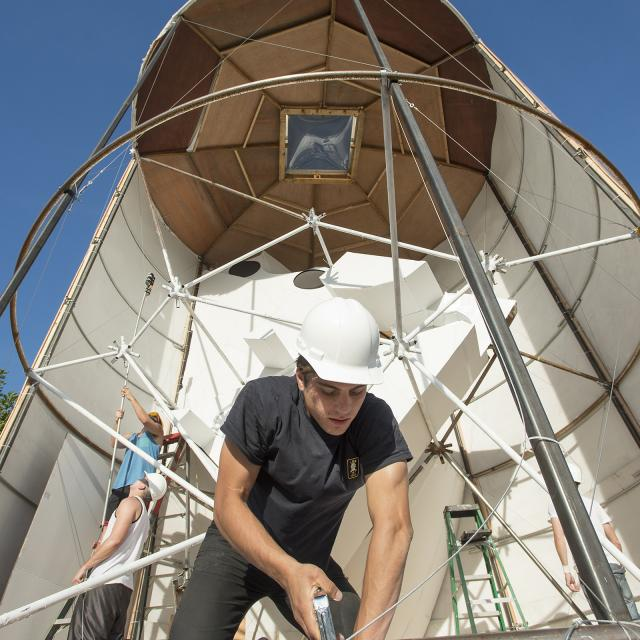 French exchange student Raphael Mougel works on an experimental Mars habitat structure, a studio project funded by NASA