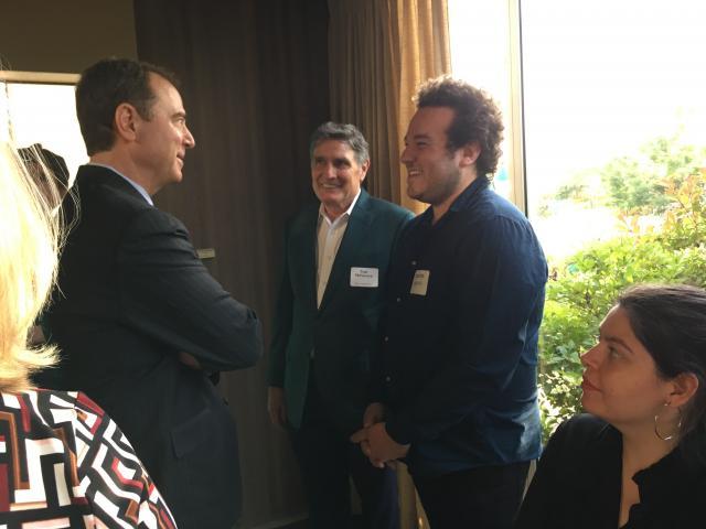U.S. Rep. Adam Schiff chats with Dion Neutra, eldest son of Richard Neutra.